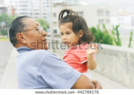 Latin grandfather with granddaughter