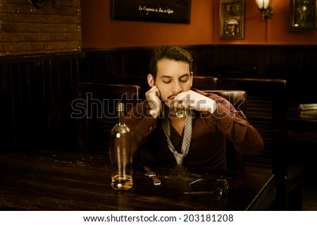 latin guy drinking shots and getting drunk - stock photo