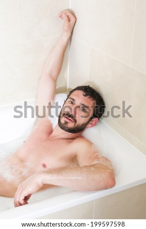 latin man relaxes in a bathtub