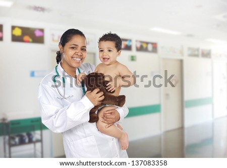 Latin pediatrician at the hospital with a beautiful baby - stock photo