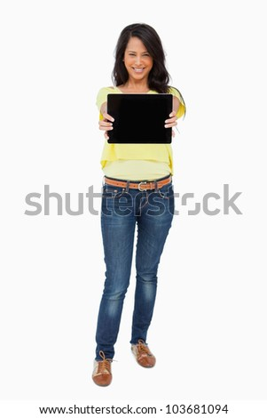 Latin student showing a touch pad screen against white background
