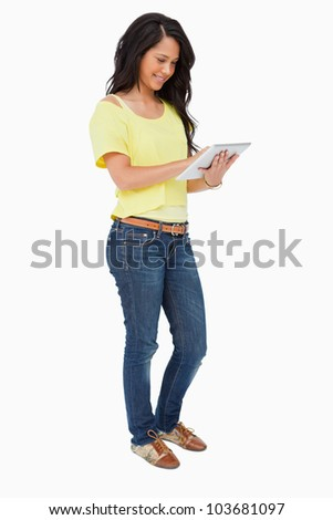 Latin student using a touch pad against white background