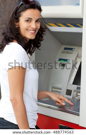Latin woman at ATM