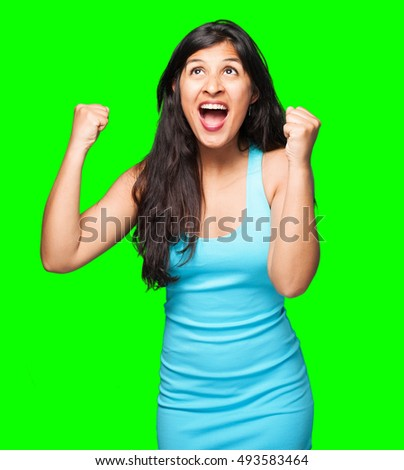 latin woman doing winner gesture