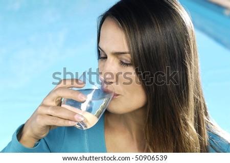 Latin woman drinking water - stock photo