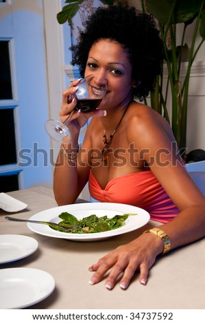 Latin woman drinking wine in a restaurant very sexy. - stock photo