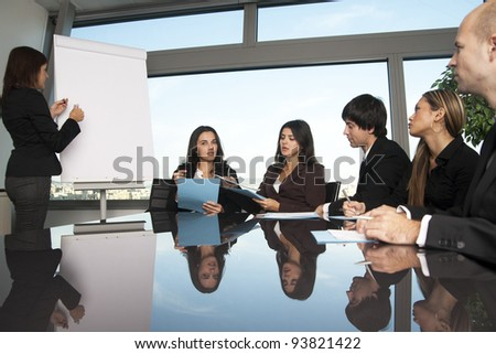 latin woman during boardroom presentation - stock photo