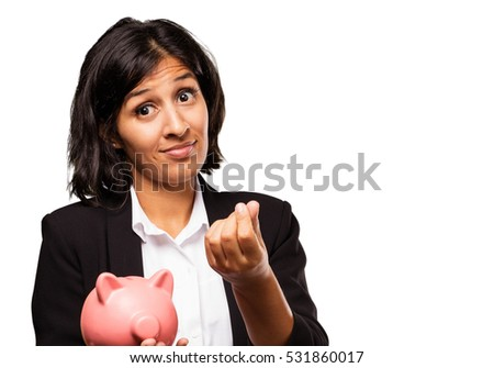 latin woman holding a piggy bank