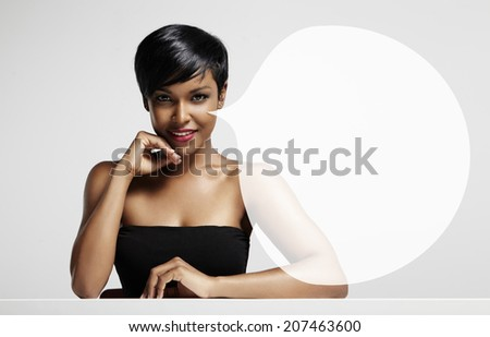 latin woman sitting at the table with transparent bubble - stock photo
