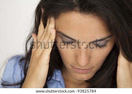 Latin woman suffering from headache