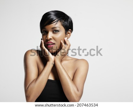 latin woman touching her face and watching at camera