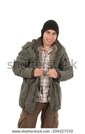 latin young man wearing green winter coat and a beanie isolated on white - stock photo