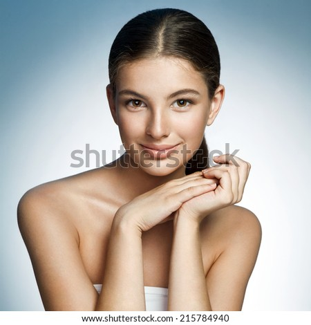 Latina girl / photograph of a cute brunette smiling girl on studio background  - stock photo