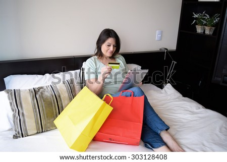 Latina middle age woman shopping online with her tablet. Shopping concept.