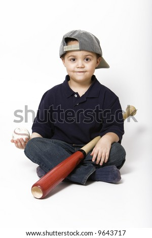 Latino boy with baseball bat and ball - stock photo