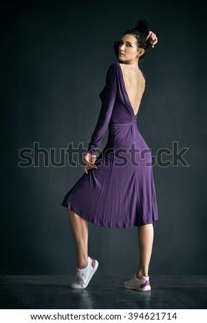 Latino dancer girl posing on dark background - stock photo