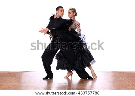 Latino dancers in ballroom against white background