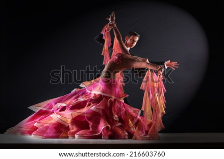 Latino dancers in ballroom isolated on black background - stock photo
