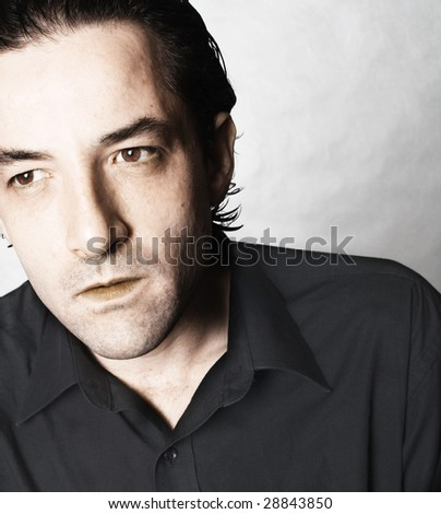 Latino Man portrait with a serious expression