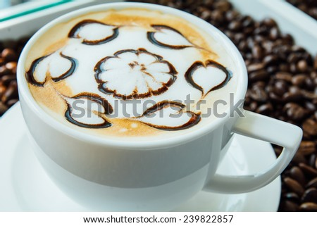 Latte art, Close up of a beautiful cup of hot coffee on coffee bean background