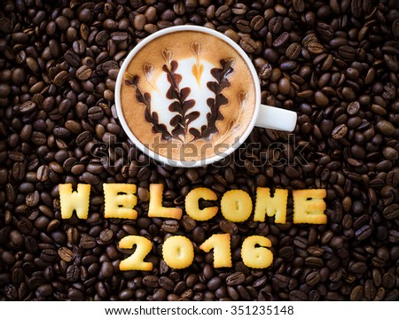 "latte art coffee and alphabet ""welcome 2016"" made from bread cookies on coffee beans background - stock photo"