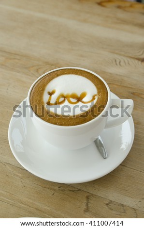 latte art coffee on wooden table background, a cup of latte art,hot coffee on wooden table. - stock photo