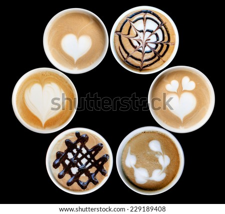 latte art design on ceramic mug isolate - stock photo