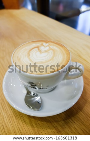 Latte art tulip and beans - stock photo