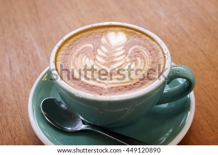 Latte Coffee art on the wooden desk - stock photo