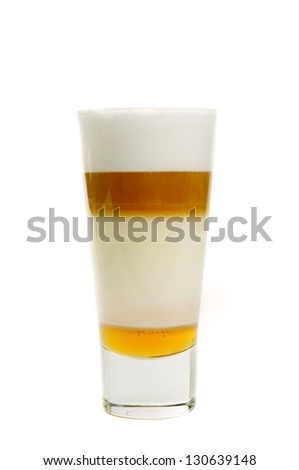 Latte coffee cocktail with yellow syrup isolated on white