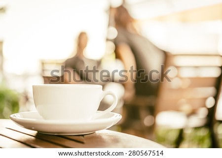 Latte coffee cup in coffee shop - vintage effect style pictures - stock photo