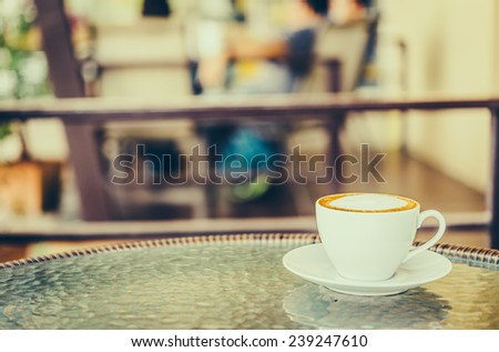 Latte coffee cup in white mug - vintage effect style pictures
