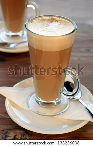Latte Coffee or caffe latte in tall latte glasses with table settings - stock photo