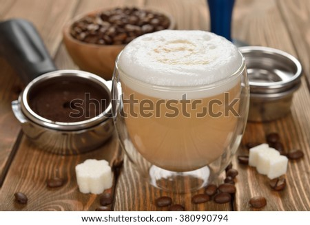 Latte in a glass on a brown background - stock photo