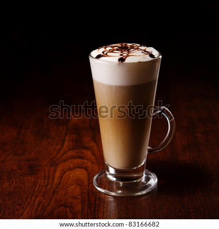 latte mug on a wooden table - stock photo