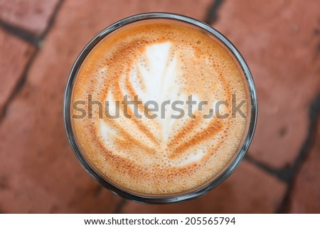 Latte or cappuccino coffee cup art swirl  - stock photo