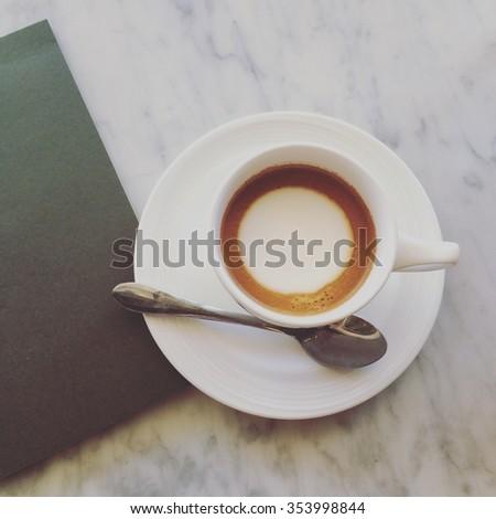 latte or cappuccino or espresso machiato coffee on marble desk in soft tone pastel retro filter effect - stock photo