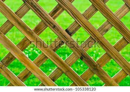 Lattice in Front of Lawn - stock photo