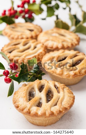 Lattice Topped Mince Pies and Holly on a White Background
