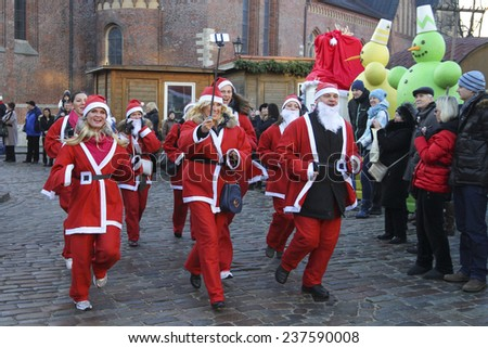LATVIA, RIGA - DECEMBER 14, 2014: Participants of the seventh annual Riga Santa's Race on Dec. 14, 2014 in Riga, Latvia