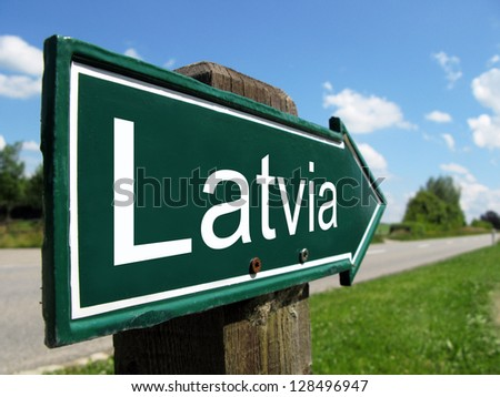 Latvia signpost along a rural road