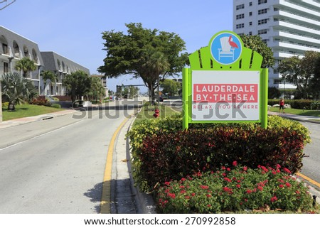 LAUDERDALE-BY-THE-SEA, FL, USA - APRIL 7, 2014: Lauderdale-By-The-Sea, Florida entrance sign in the median of Highway A1A seen from Fort Lauderdale which is south of the city.  - stock photo
