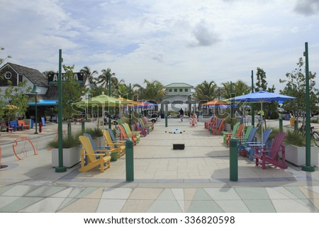 Lauderdale-By-The-Sea, FL, USA - September 20, 2014: Renovated and redesigned colorful plaza with relaxing chairs, umbrellas, walkways near the pavilion  - stock photo