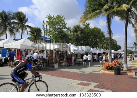 LAUDERDALE-BY-THE-SEA, FLORIDA - OCTOBER 28: Many people looking in many outdoor tents filled with local art at the 14th annual craft festival on October 28, 2012 in Lauderdale-By-The-Sea, Florida. - stock photo