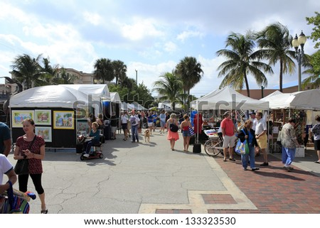 LAUDERDALE-BY-THE-SEA, FLORIDA - OCTOBER 28: Many people shopping at the outdoor annual craft festival where local artists display outside on October 28, 2012 in Lauderdale-by-the-Sea, Florida. - stock photo