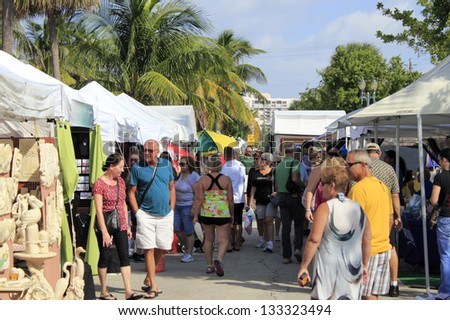 LAUDERDALE-BY-THE-SEA, FLORIDA - OCTOBER 28: People looking at the 14th annual craft festival where local artists display at outdoor galleries on October 28, 2012 in Lauderdale-by-the-Sea, Florida. - stock photo