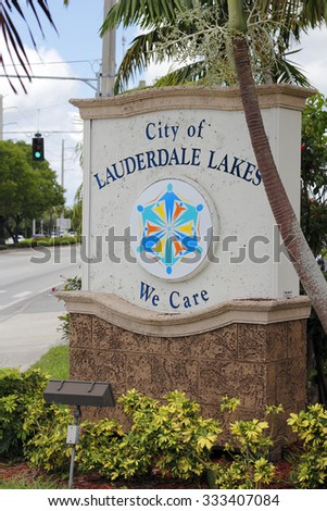 Lauderdale Lakes, FL, USA - July 11, 2014: City of Lauderdale Lakes We Care sign along the street during the day. Entrance sign to Lauderdale Lakes, Florida.