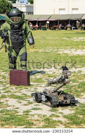 LAUDUN, FRANCE - MAY 01, 2014: Bomb Squad specialiste and vehicle equipped with a remote-controlled robot, detection and detonation equipment during French Foreign legion open Day on May 01, 2014 - stock photo