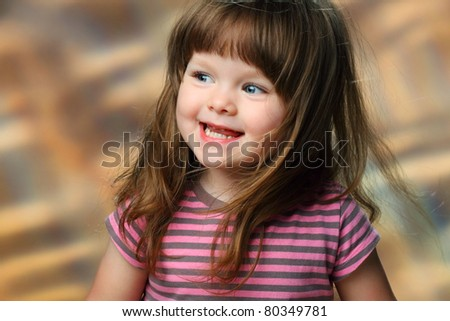 laugh a little girl at the studio shooting - stock photo