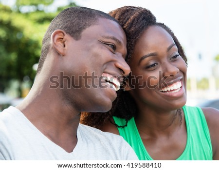 Laughing african american love couple in the city